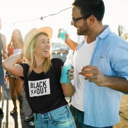 t-shirt-mockup-featuring-a-happy-woman-at-a-rooftop-party-41153-r-el2